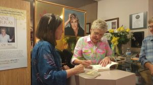 Anne signing